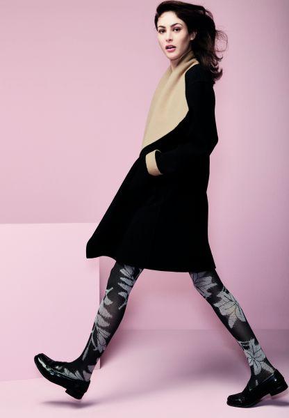 Elegant tvåfärgad strumpbyxa med floralt mönster Diors från Omero